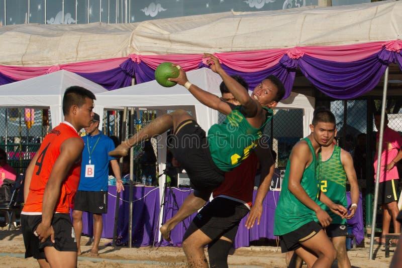 Beach Handball, player making a service at The 2018 Thailand National Games, Jiang Hai Games. Chiang Rai, Thailand - November 19, 2018 : Beach Handball player stock image