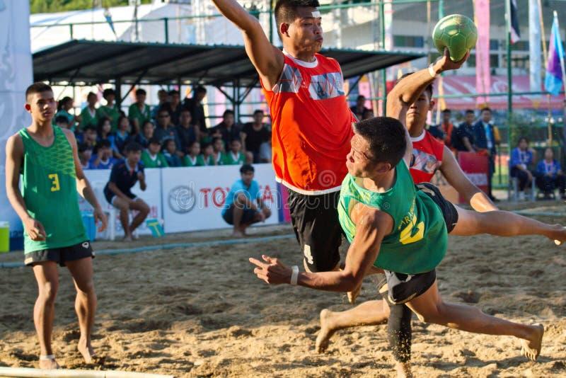 Beach Handball, player making a service at The 2018 Thailand National Games, Jiang Hai Games. Chiang Rai, Thailand - November 19, 2018 : Beach Handball player stock photos