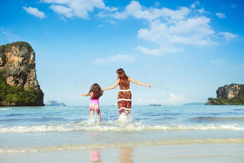 On the beach. Happy mother and young daughter on the beach royalty free stock photo