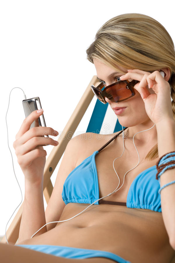 Beach - Happy woman in bikini relax with music stock images