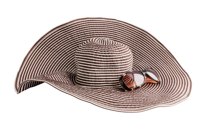 Beach hat. Large beach hat and glasses from the sun royalty free stock photography