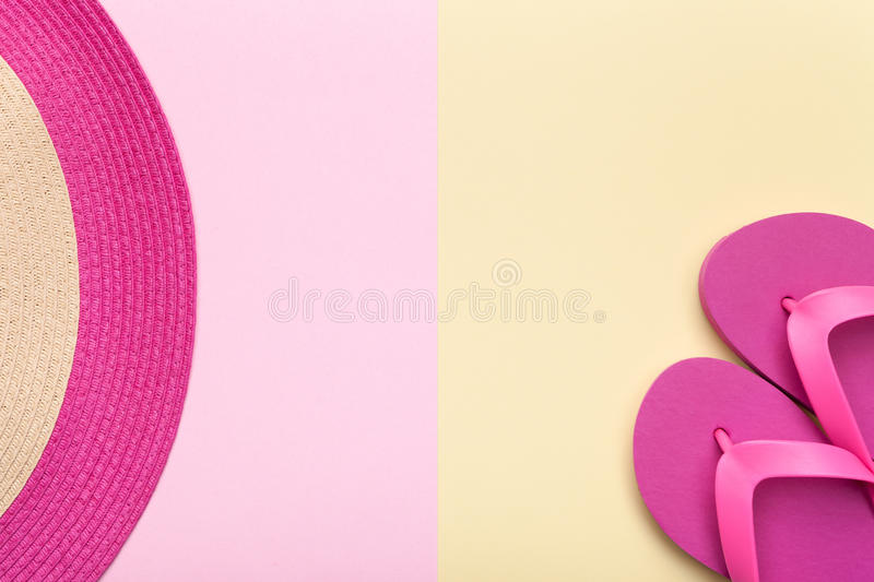 Beach Hat and Flip Flops on Pastel Background royalty free stock images