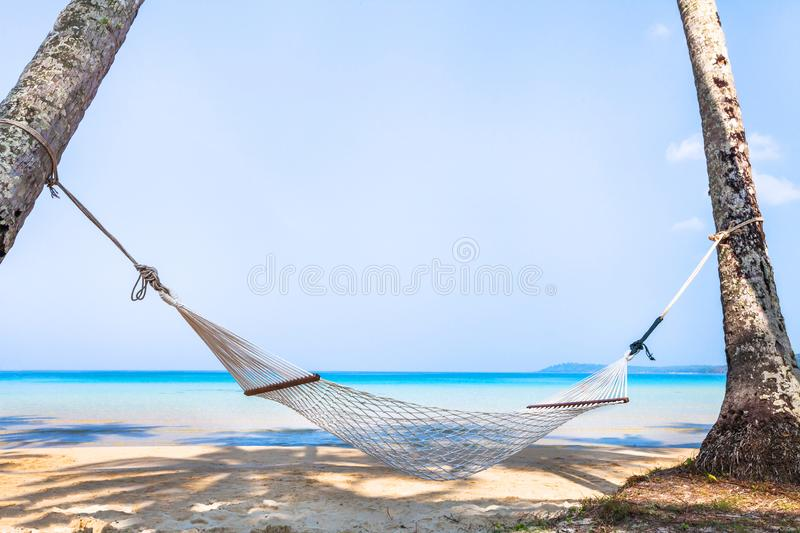 Beach holidays on tropical island, beautiful hammock in hotel, relaxation concept, vacation royalty free stock photography