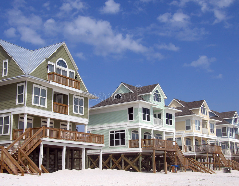 Beach Homes on Blue Sky Background stock photos
