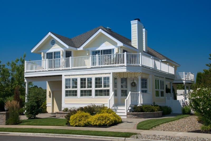 Beach House. Contemporary beach house; pastel yellow against deep blue sky