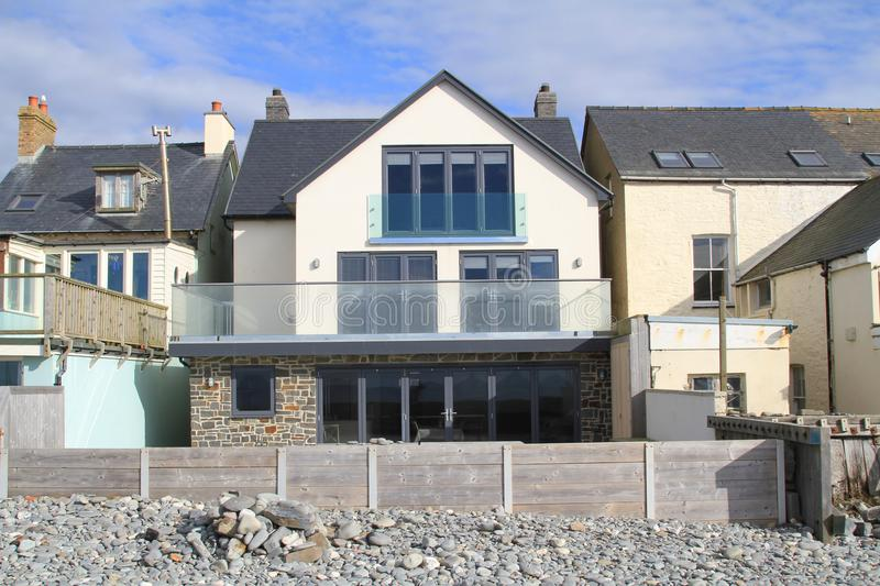 Beach house in Borth, Wales. A beach house located by the beach at the seaside town of Borth on the coast of Cardigan Bay Wales royalty free stock photos