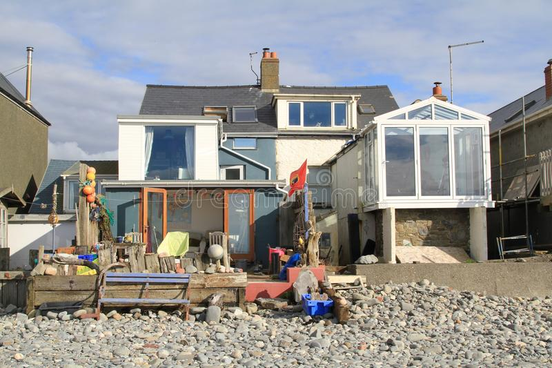 Beach house in Borth, Wales. A beach house located by the beach at the seaside town of Borth on the coast of Cardigan Bay Wales royalty free stock photography