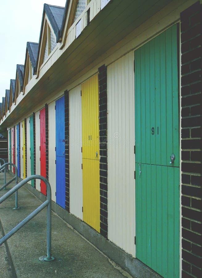 Beach hut doors Lowestoft Suffolk. Beach hut and locker doors Lowestoft Suffolk coast promenade multicoloured stock photography