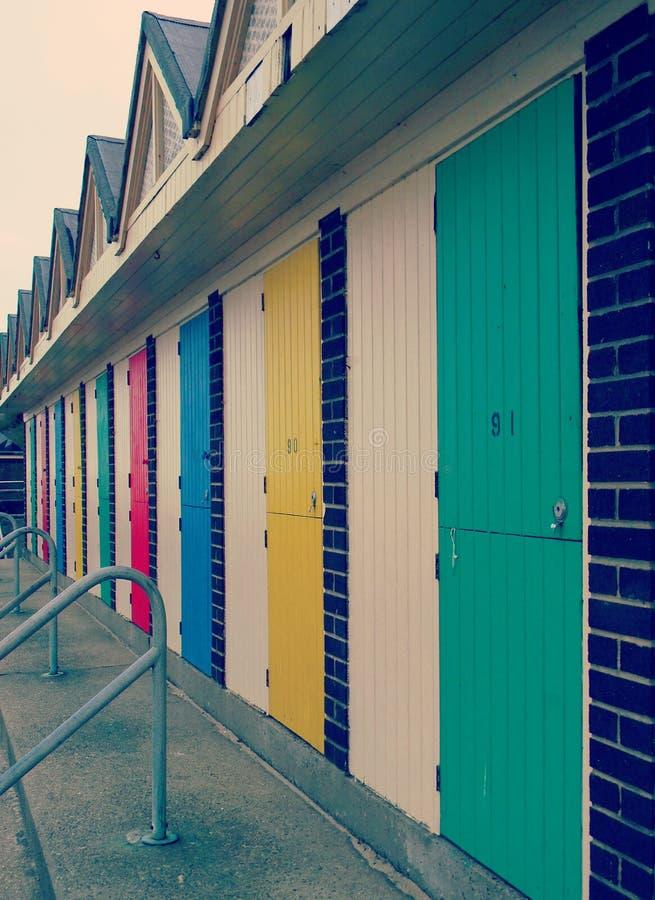 Beach hut doors Lowestoft Suffolk. Beach hut and locker doors Lowestoft Suffolk coast promenade vintage filter stock photography