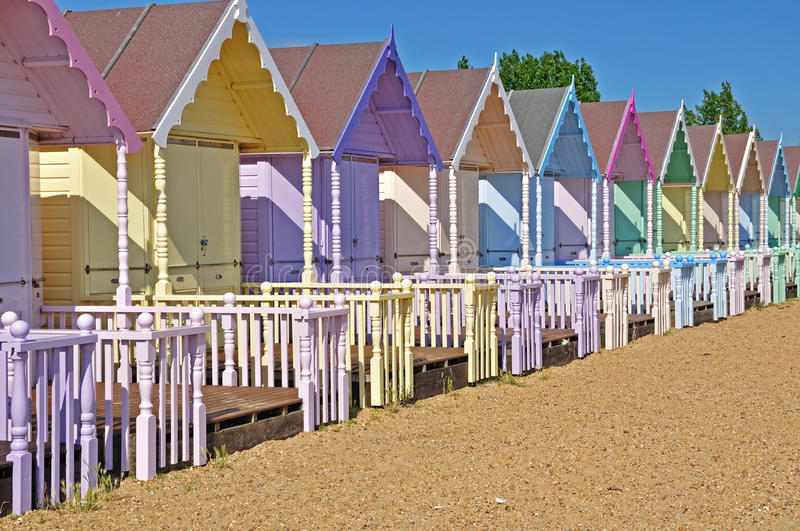 Beach Huts. Line of Colourful Beach huts stock images