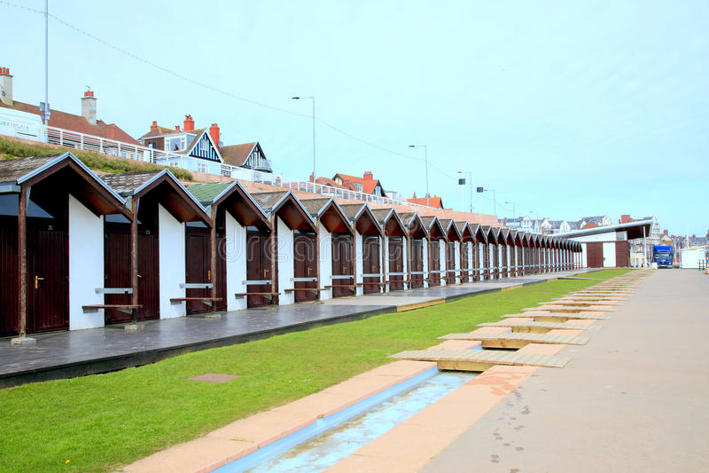 Beach huts, Bridlington, Yorkshire. BRIDLINGTON, NORTH YORKSHIRE, UK. APRIL 22, 2015. A row of beach huts in perspective uniformity on the seafront at stock images