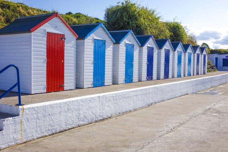 Beach huts Brixham Torbay Devon Endland UK. Colorful colourful beach huts Brixham Torbay (English Riviera) Devon Endland UK stock photo