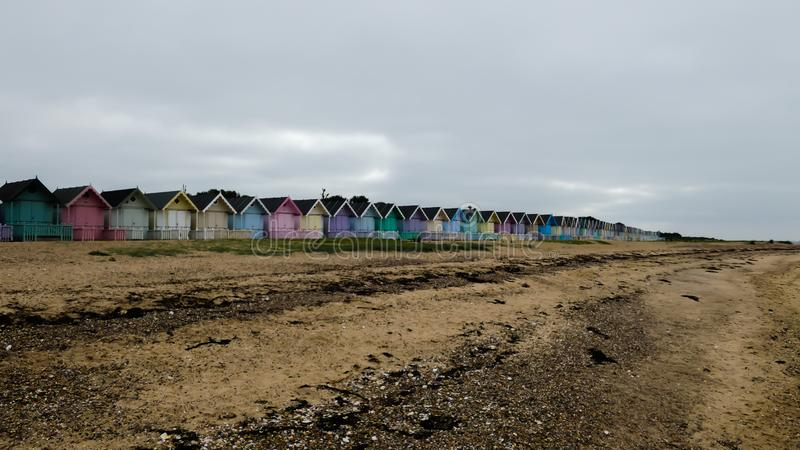Beach Huts in England after a storm in West Mersea, England UK stock image