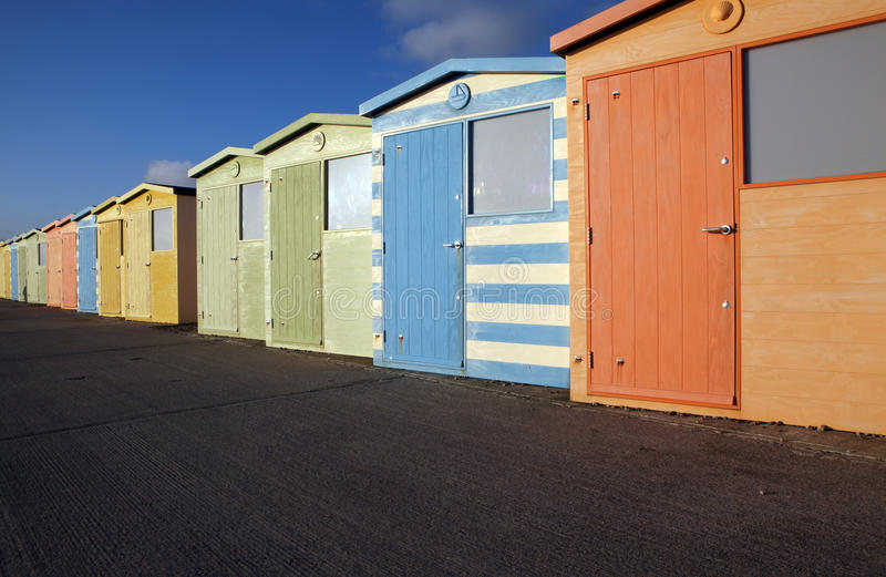 Beach huts english seaside. Beach huts in seaford by brighton in sussex england. colorful sheds by the seaside against bright blue sky stock image