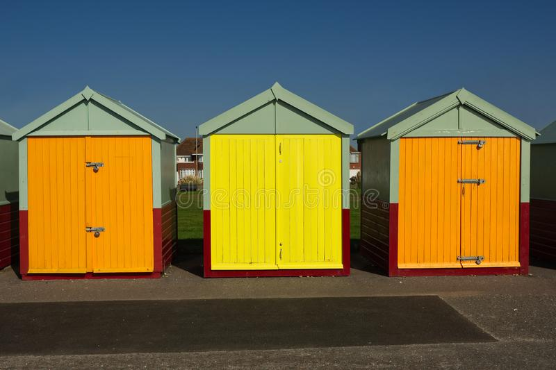 Beach huts at Hove, Sussex, England. Colourful beach huts on the seafront promenade at Hove, Brighton, East Sussex, England stock image