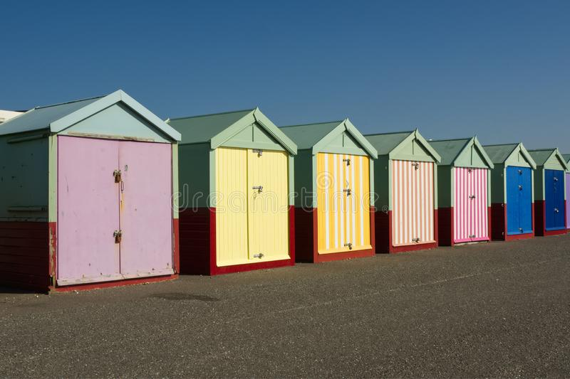 Beach huts at Hove, Sussex, England. Colourful beach huts on the seafront promenade at Hove, Brighton, East Sussex, England royalty free stock images