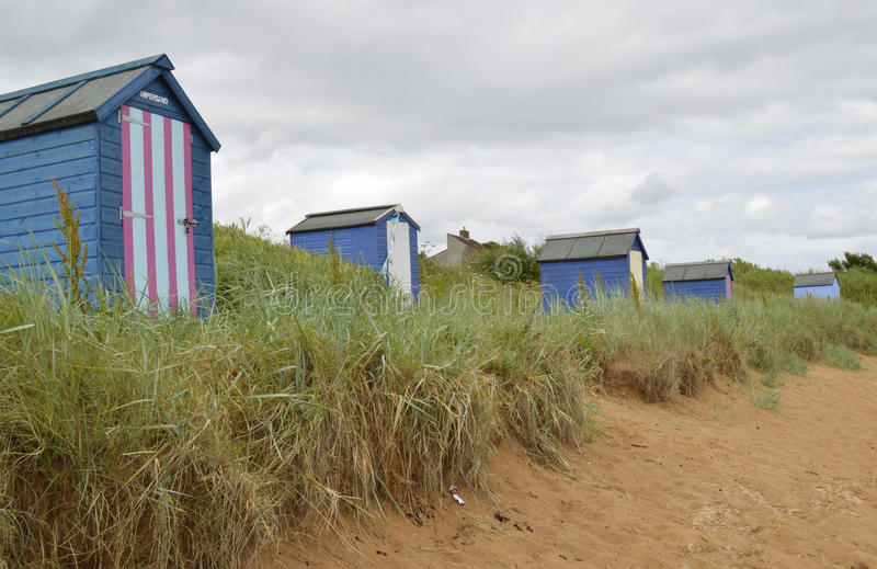 Beach Huts. Landscape view. Row of beach huts on a grass verge royalty free stock images