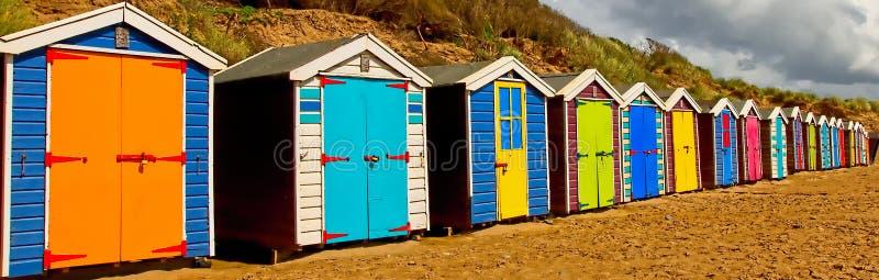 Beach-huts North Devon beach. Muti-coloured beach-huts north devon coast stock photography