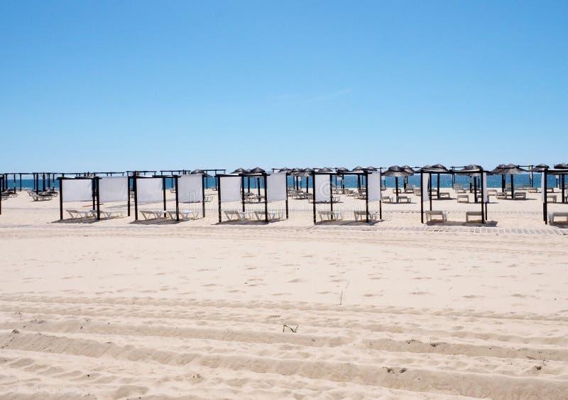 Beach Huts On Beach At Praia Do Barril Tavira Portugal stock photos