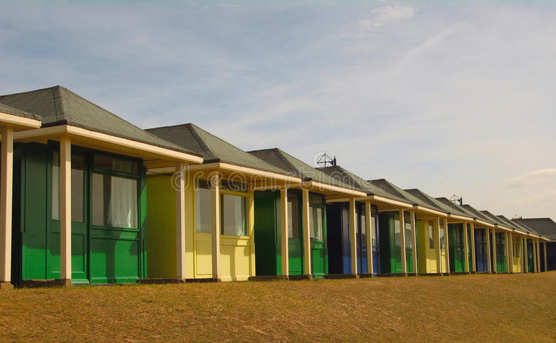 Beach Huts. A run of brightly coloured beach huts at a typical English seaside resort royalty free stock photo