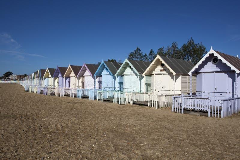 Beach Huts, West Mersea, Essex, England. Beach Huts against a blue sky at West Mersea, Essex, England stock photography