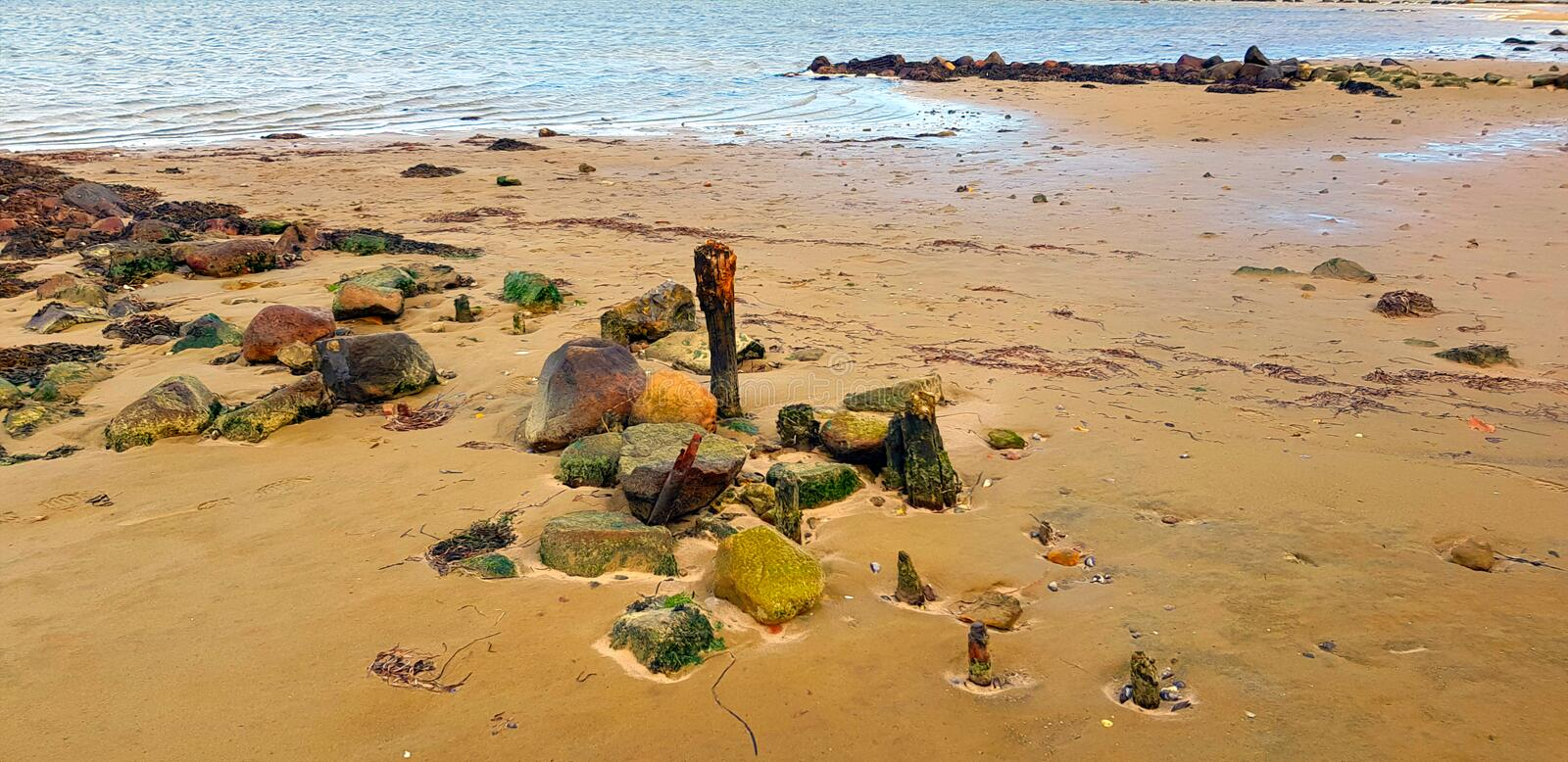 Beach idyll with stones and sand stock photo
