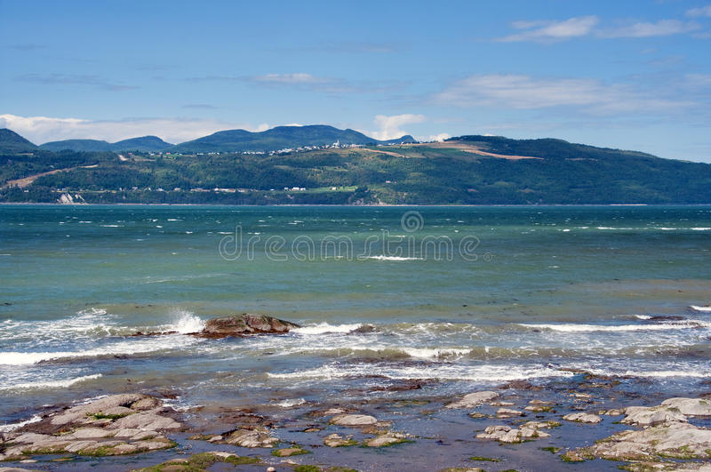 Beach on Ile-aux-Coudres. View from ile-aux-coudres of St. Joseph de la Rive in beautiful Charlevoix, Quebec on the Saint Lawrence stock photos