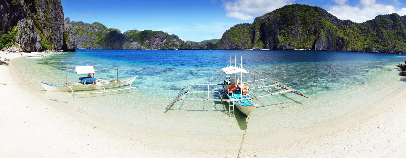 Beach at Island. El Nido, Philippines. Boats on a beach at Island. El Nido, Philippines royalty free stock photography