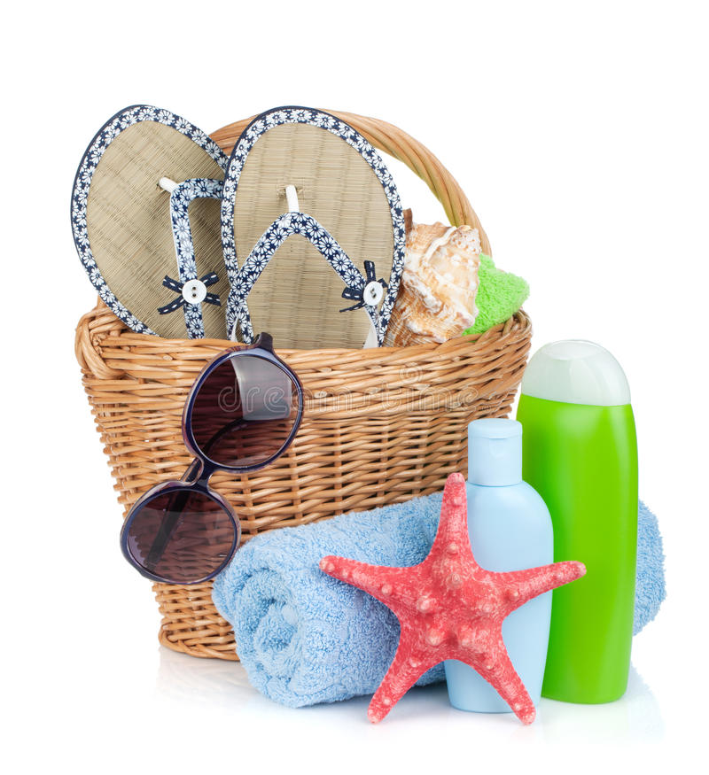 Beach items in basket. Isolated on white background royalty free stock photography