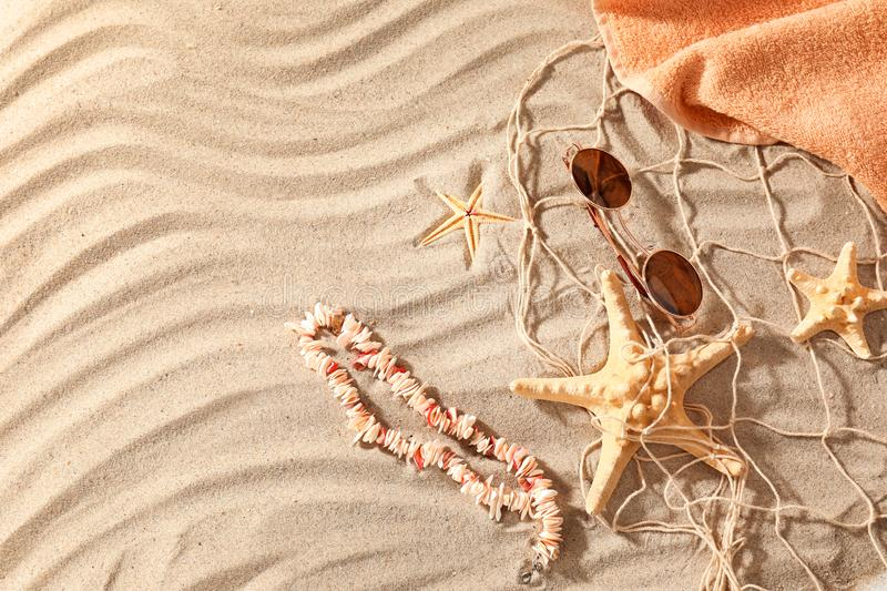 Beach items with net and starfishes on sand royalty free stock photos