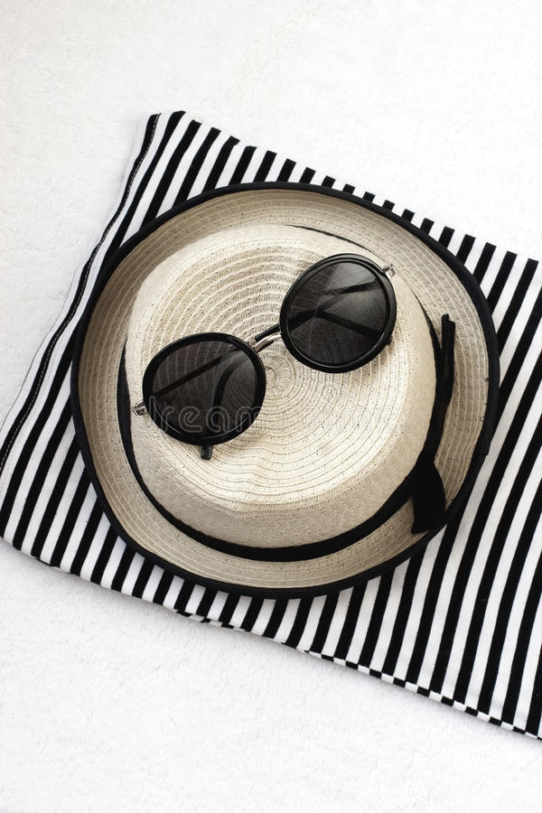 Free Beach Items With Straw Hat,towel And Sunglasses On Wooden Background Stock Photo - 53776810
