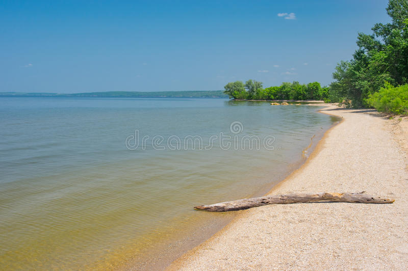 Beach on Kakhovka Reservoir located on the Dnepr River, Ukraine. Empty beach on Kakhovka Reservoir located on the Dnepr River, Ukraine stock photography