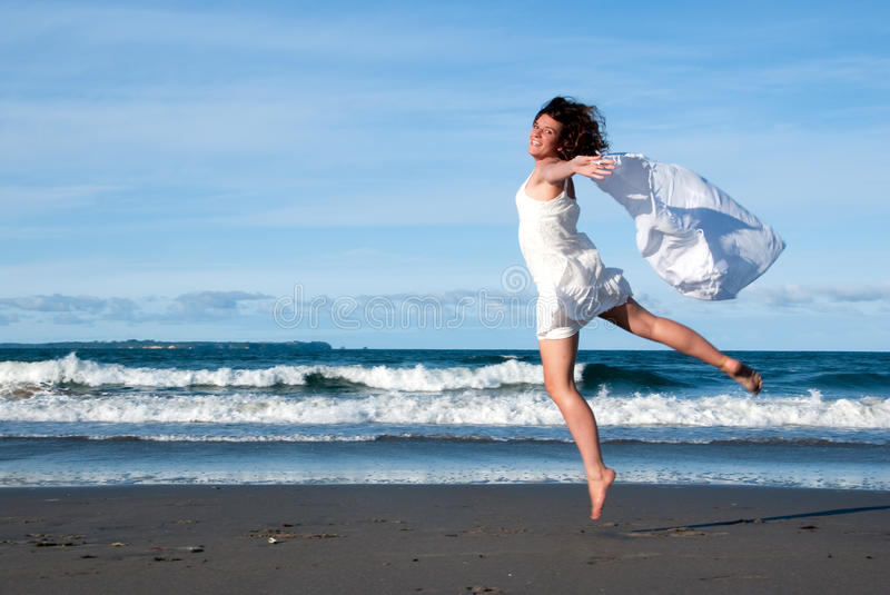Beach leap stock images
