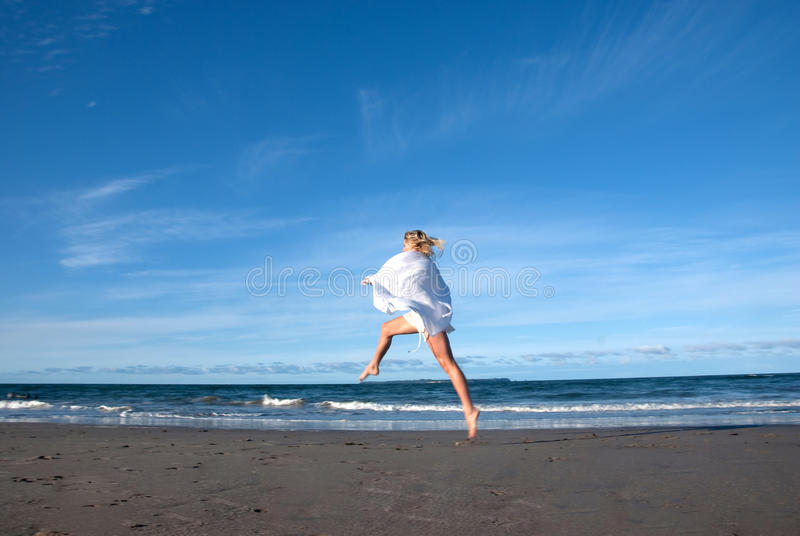 Beach leap royalty free stock photos