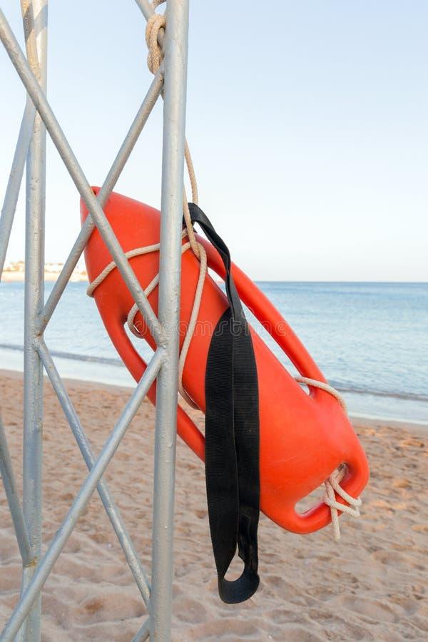 Beach life-saving. lifeguard tower with orange buoy on the beach. rescue buoy on the iron rescue post.  royalty free stock photos