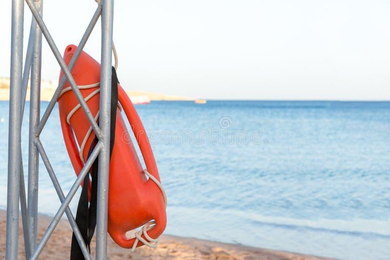 Beach life-saving. lifeguard tower with orange buoy on the beach. rescue buoy on the iron rescue post.  stock images