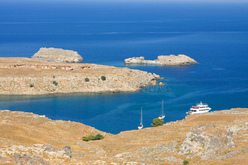Beach in Lindos, Rhodes, one of the Dodecanese Islands in the Aegean Sea, Greece. View from above of the main beach in Lindos, Rhodes, one of the Dodecanese royalty free stock images