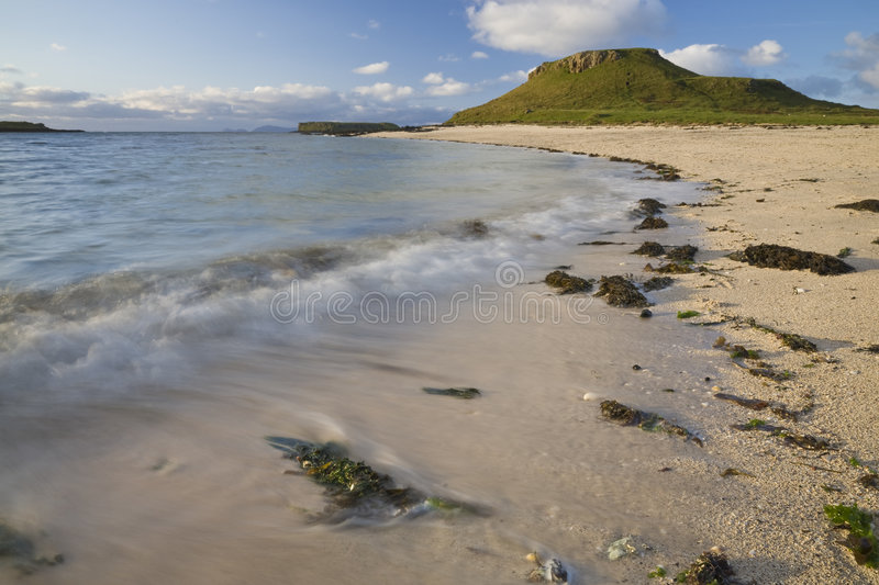 Beach line with blue sky, clouds and green grass stock photos