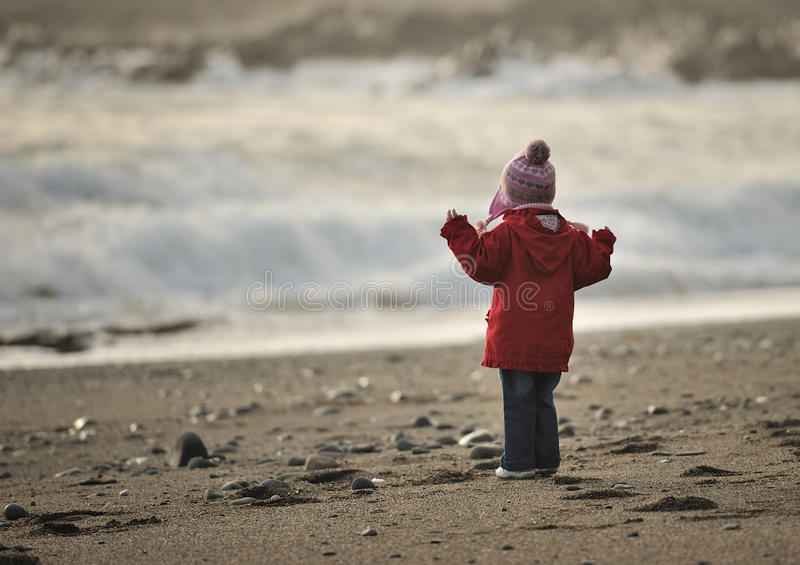 At the Beach. Little girl looking at the ocean stock photography