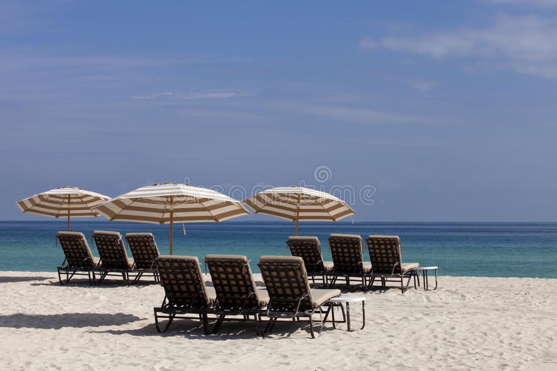 Beach Lounge Chairs and Umbrellas royalty free stock images