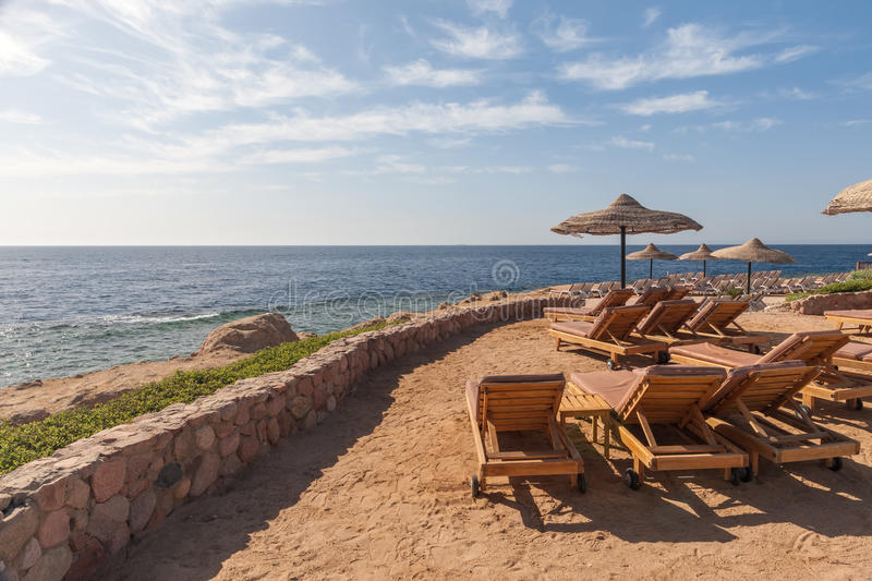 Beach at the luxury hotel, Sharm el Sheikh, Egypt. The beach at the luxury hotel, Sharm el Sheikh, Egypt. chairs and umbrellas royalty free stock photos