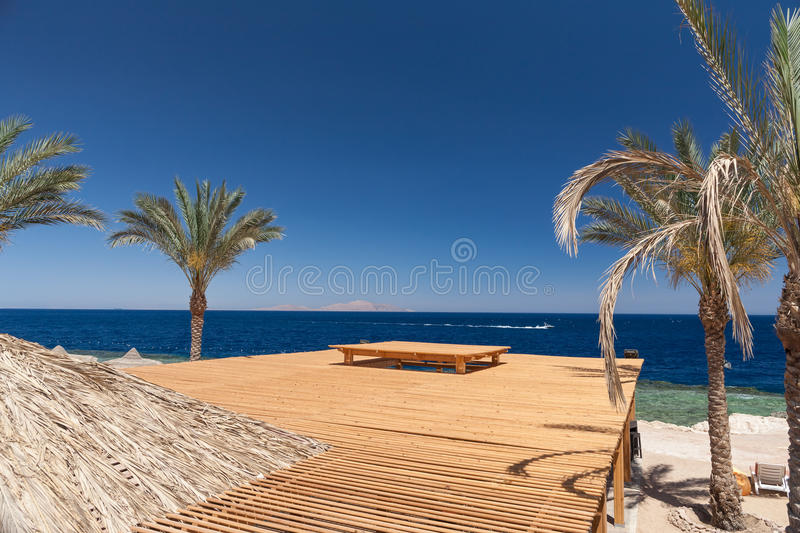 Beach at the luxury hotel, Sharm el Sheikh, Egypt. The beach at the luxury hotel, Sharm el Sheikh, Egypt. top view of the wooden roof stock image