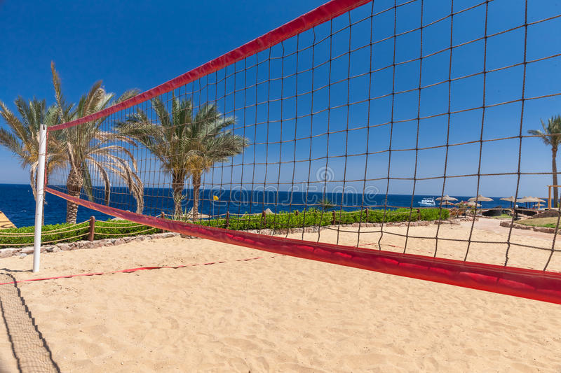 Beach at the luxury hotel, Sharm el Sheikh, Egypt. The beach at the luxury hotel, Sharm el Sheikh, Egypt. view from the net of volleyball court royalty free stock photos