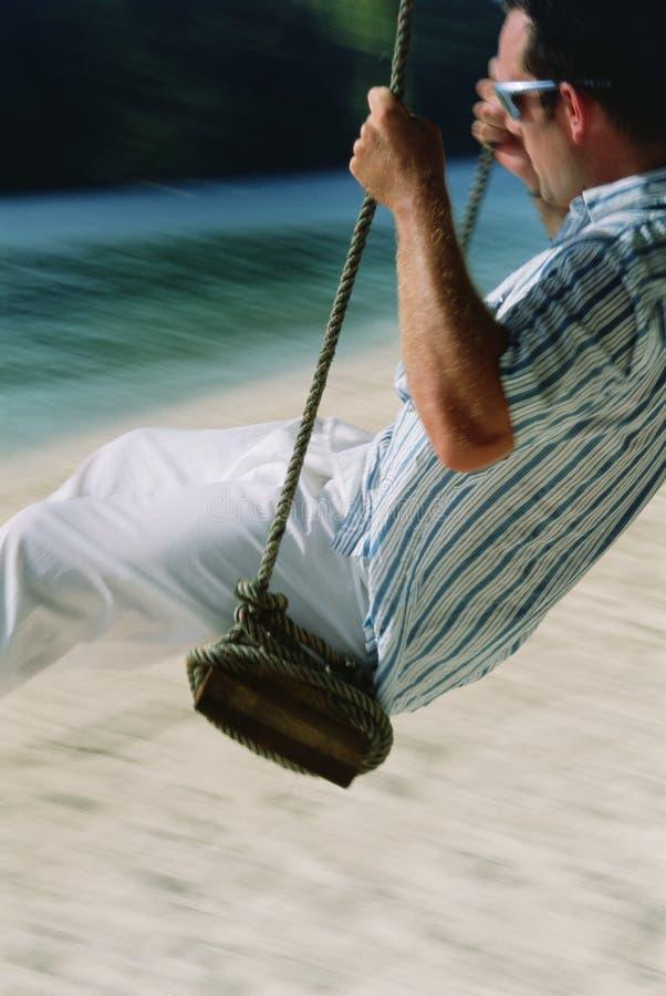 beach man swing στοκ φωτογραφία με δικαίωμα ελεύθερης χρήσης