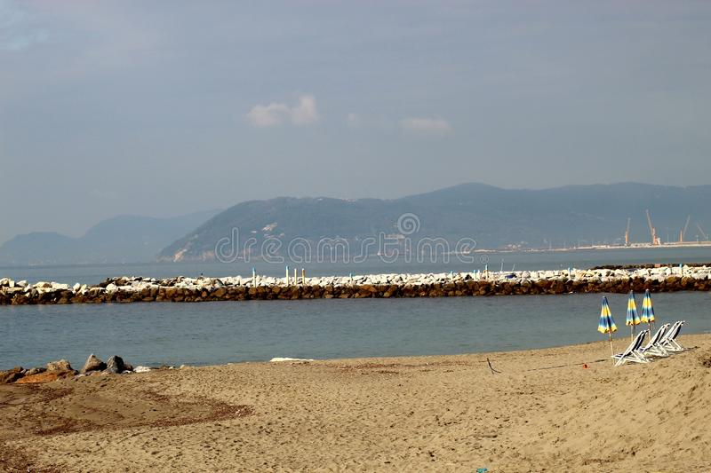 A beautiful autumn sunny day at the beach. This is the beach in Marina di Massa in Italy. It was a sunny day. The sea was calm. Beautiful blu color stock images