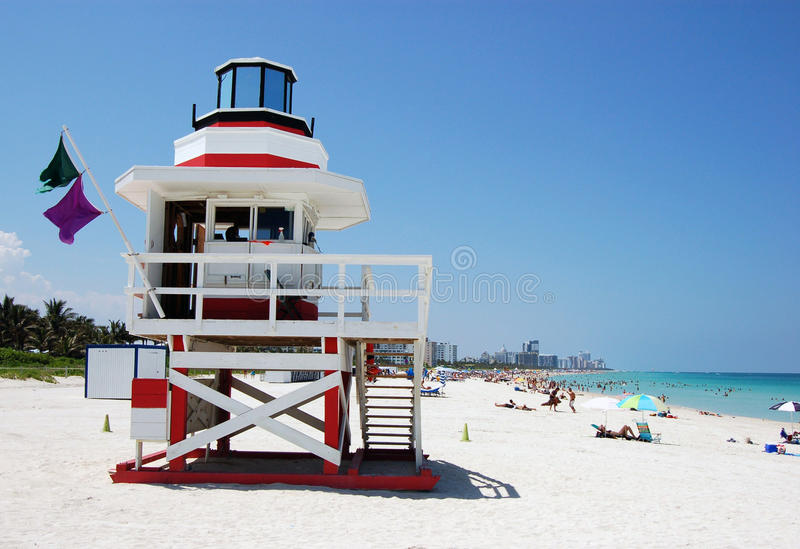 The Beach on Miami Beach. Looking north from South Pointe park with a red and white lifeguard stand in the foreground,bathers in the background and in the royalty free stock photo