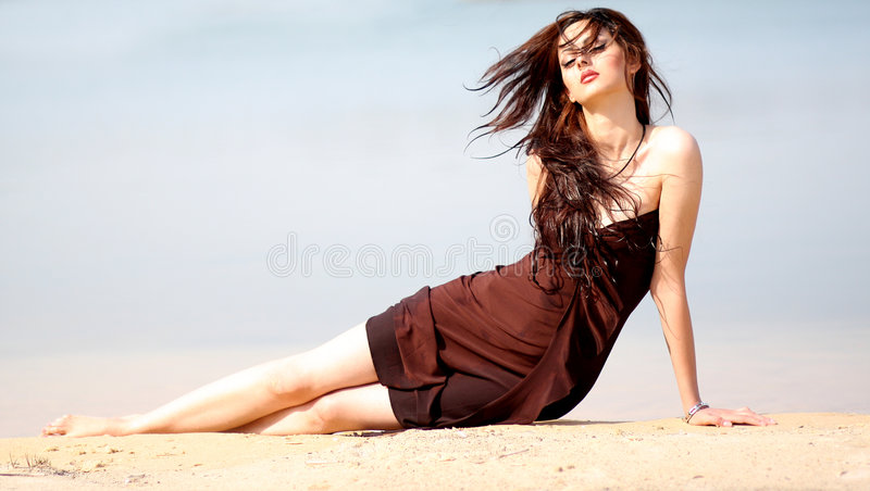 Beach model2. Beautiful girl modeling at the beach royalty free stock photography