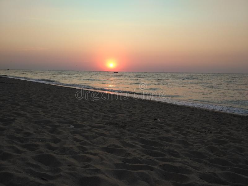 Beach morning red sun sunrise sand the black sea the waves royalty free stock image