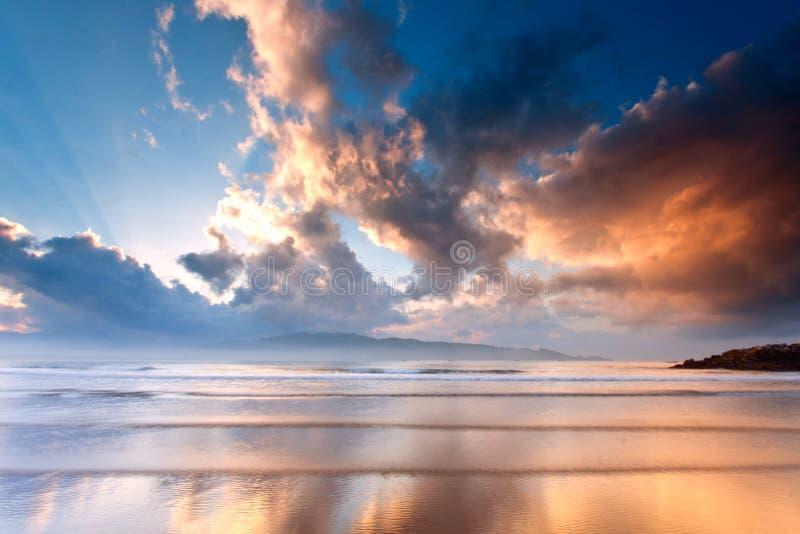 Beach in the morning sunrise stock photo