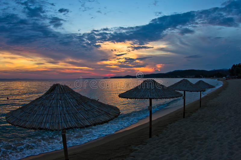 Beach near small greek village Toroni at sunset in Sithonia royalty free stock images